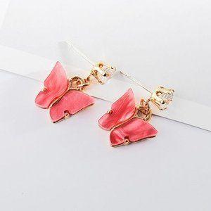 3/$20 Fuchsia Resin Butterfly Rhinestone Earrings